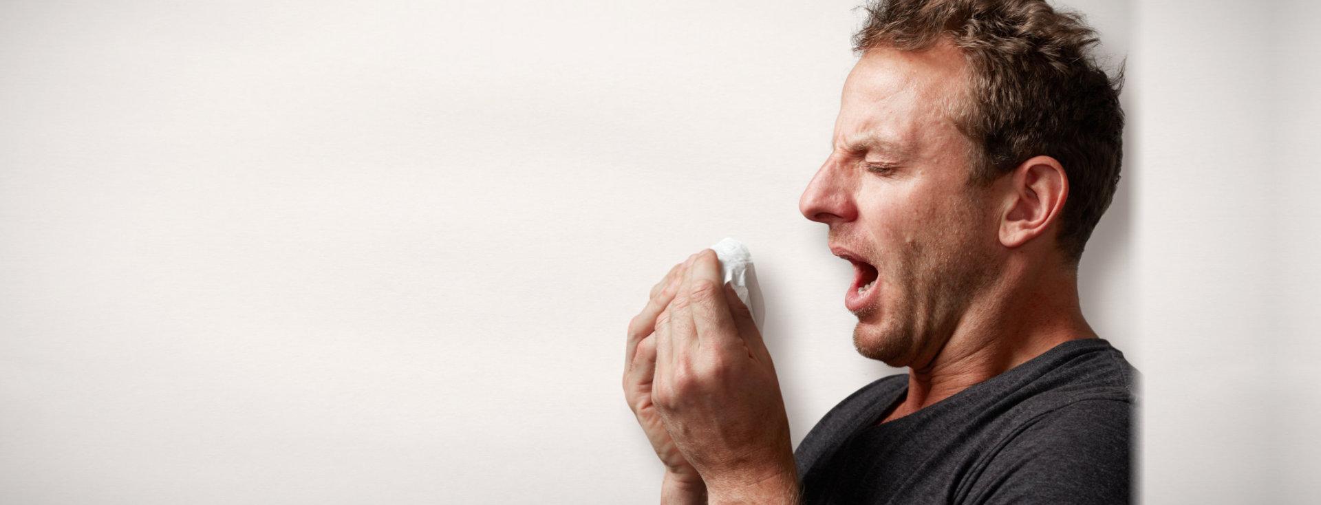 sneezing gent