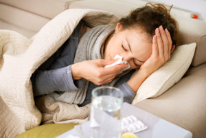 woman lying in bed having an allergy